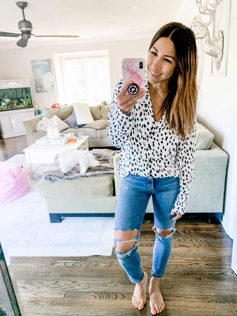 Amazon Haul July by top US fashion blog, House of Leo Blog: image of woman wearing Ecowish leopard tunic and Agolde Sophie crop jeans