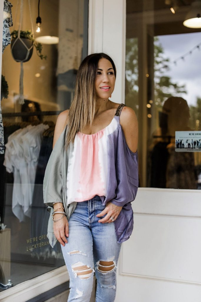 3 Gorgeous Pieces From Paulita Carlotta by top US fashion blog, House of Leo Blog: image of woman wearing silk tie dye cold shoulder top