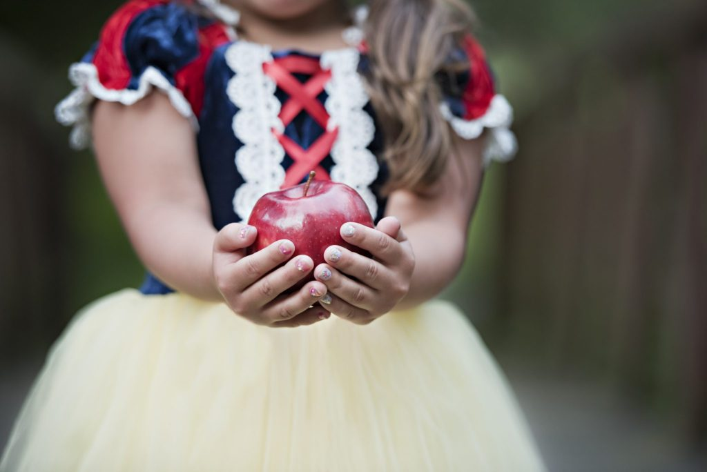 Princess Sessions With April Narby by top US lifestyle blog, House of Leo Blog: image of little girl holding an apple