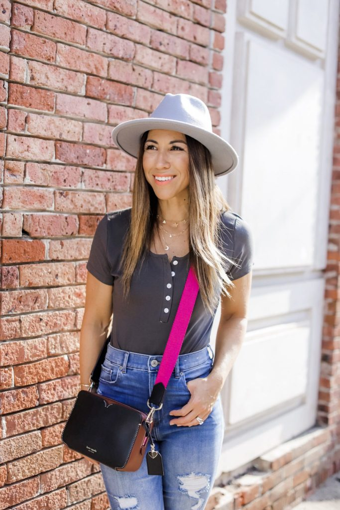Affordable Fall Pieces to Buy Now by top US fashion blog, House of Leo Blog: image of woman wearing gray wool fedora hat and Kate Spade camera bag
