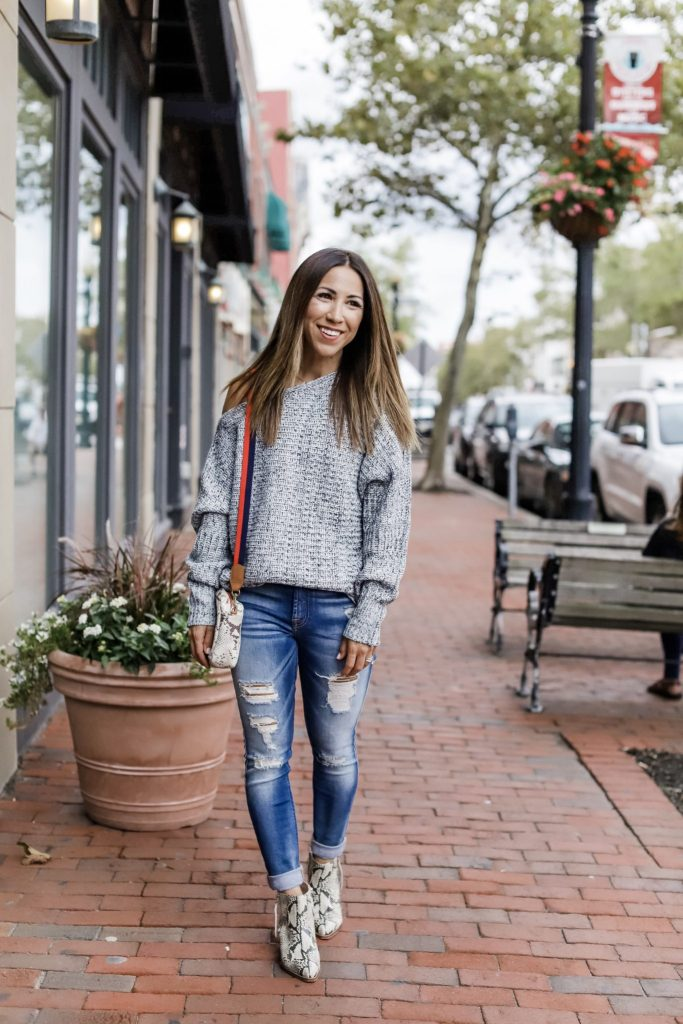 How to Style Snakeskin Print by top US fashion blog, House of Leo Blog: image of woman wearing gray off the shoulder sweater, 7 for all mankind skinny ankle distressed jeans, Sam Edelman Walden booties