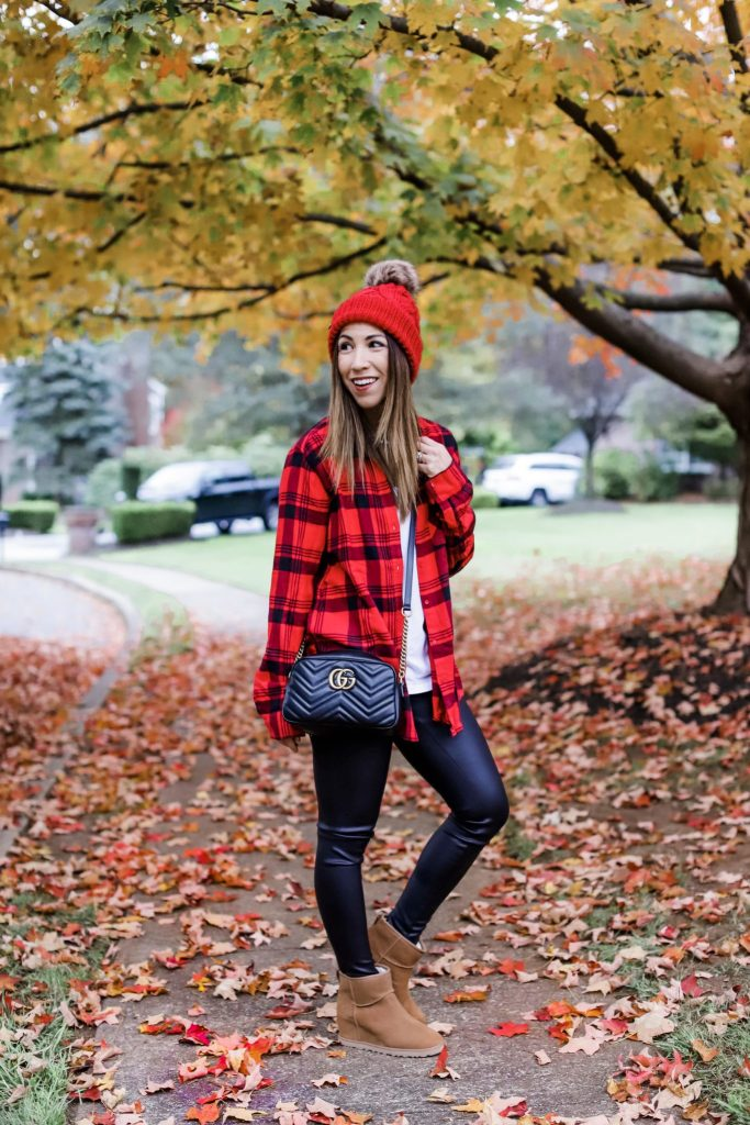 Affordable Fall Favorites From Express by top US fashion blog, House of Leo Blog: image of woman wearing Gucci camera bag, red and black flannel and UGG wedges