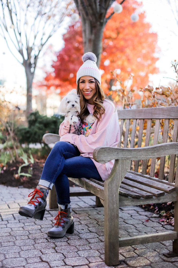 Holiday Outfit Ideas From Evereve by top US fashion blog, House of Leo Blog: image of woman wearing pink Rolling Stones sweatshirt, and Sorel Blake boots