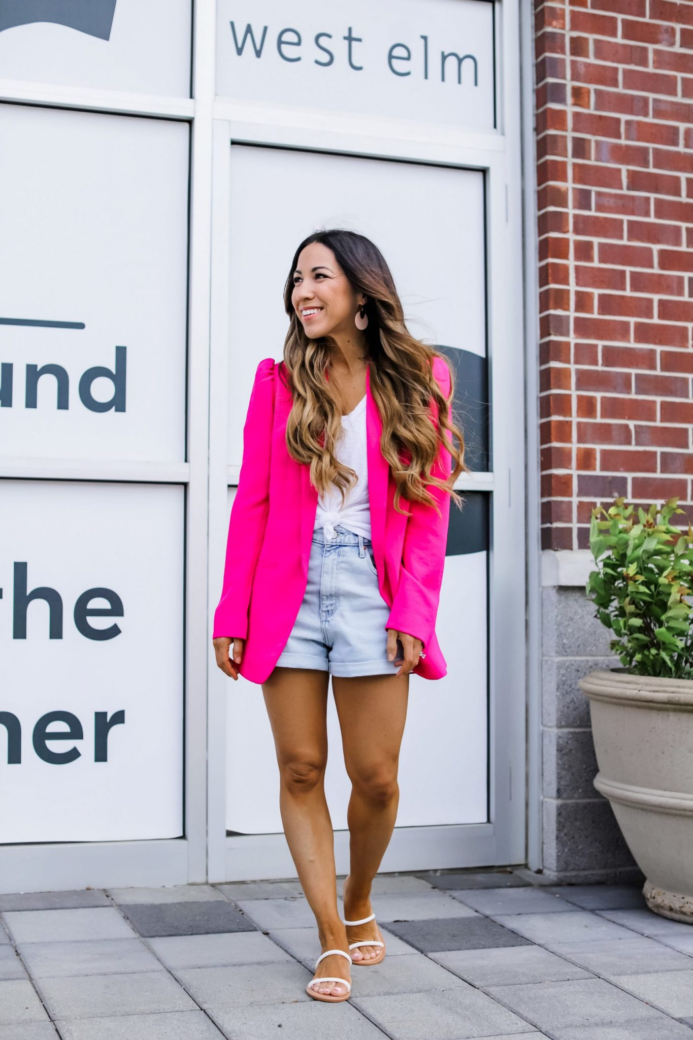 May Finds From Express by top US fashion blog, House of Leo Blog: May finds from Express, image of woman wearing pink blazer with denim shorts