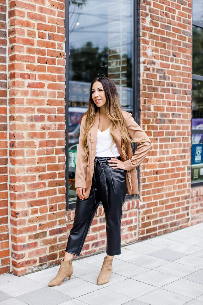 September Finds From Express by top US fashion blog, House of Leo Blog: September finds from Express, image of woman wearing orange satin silk blazer and black tie waist faux leather ankle pants