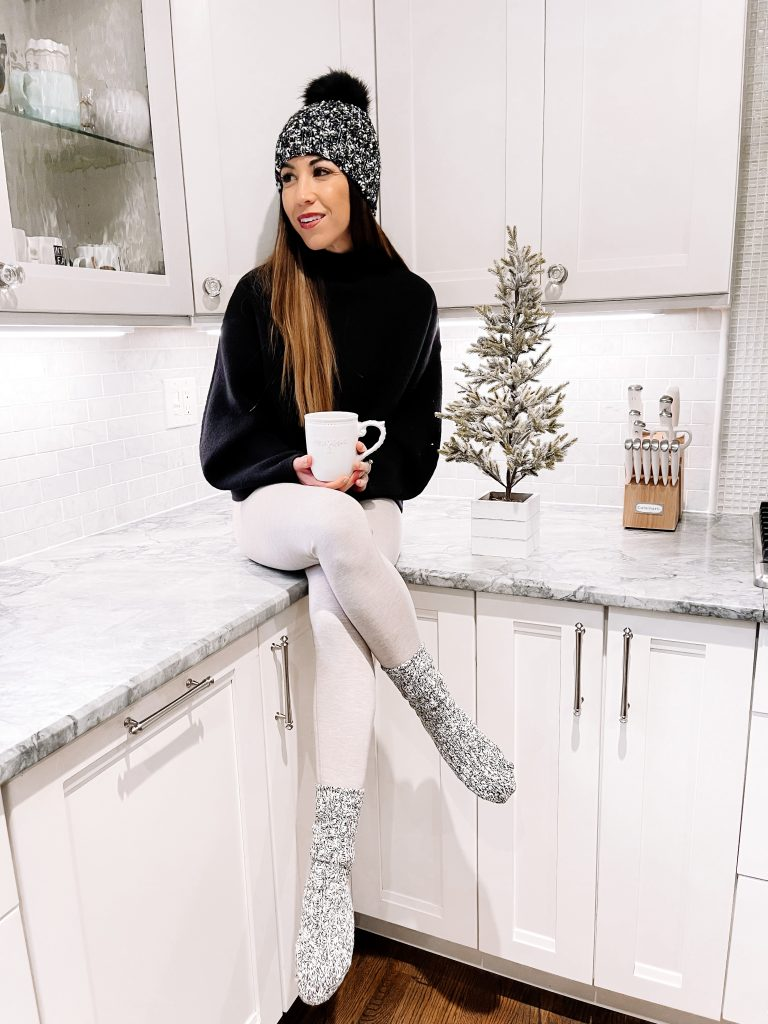November Finds From Express by top US fashion blog, House of Leo Blog: November finds from Express, image of black mock neck sweater and ivory leggings