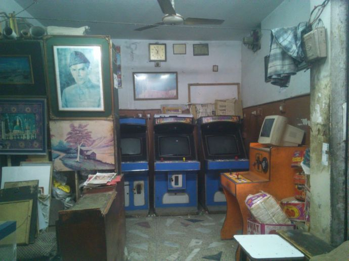 The last 'game shop' in Lalkurti, Rawalpindi. The owner uses it to store fruits and other ware that he sells on his cart outside the shop during the day. There were 9 other shops in the vicinity when he installed his 'gaming facilities' 13 years ago. Now his is the only one left, and even his customers are few.
