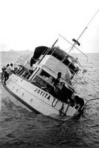 MV Joyita. The ship was partially submerged and listing heavily to port side