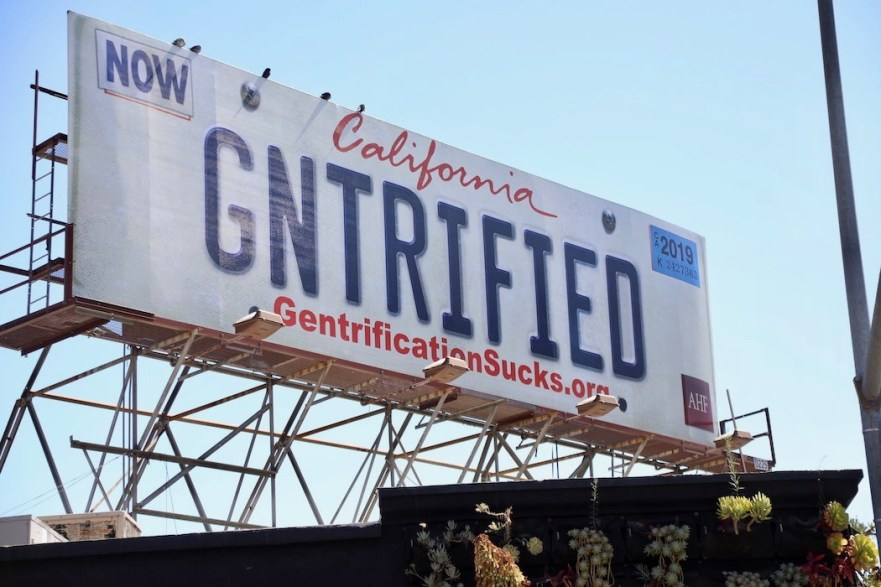 Housing Is A Human Right gntrified billboard