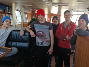 The crew wearing their woolly hats!
