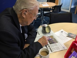 Bob looking at his picture in the Telegraph