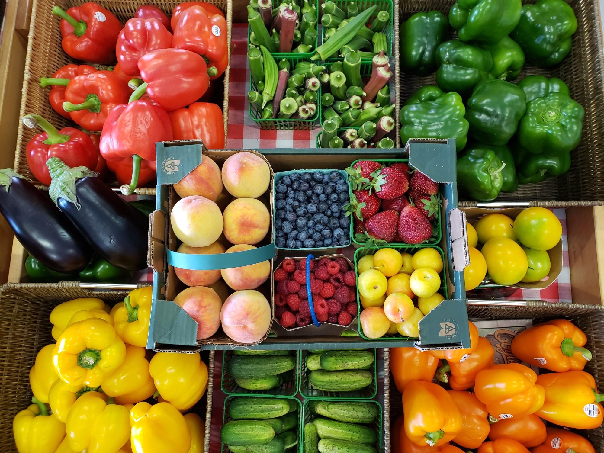Fruit basket on top of fresh vegetables