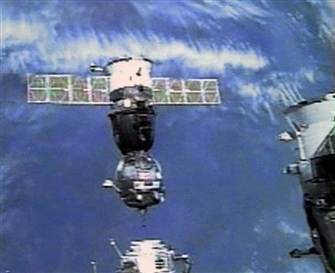 Soyuz spacecraft docks at International Space Station ...