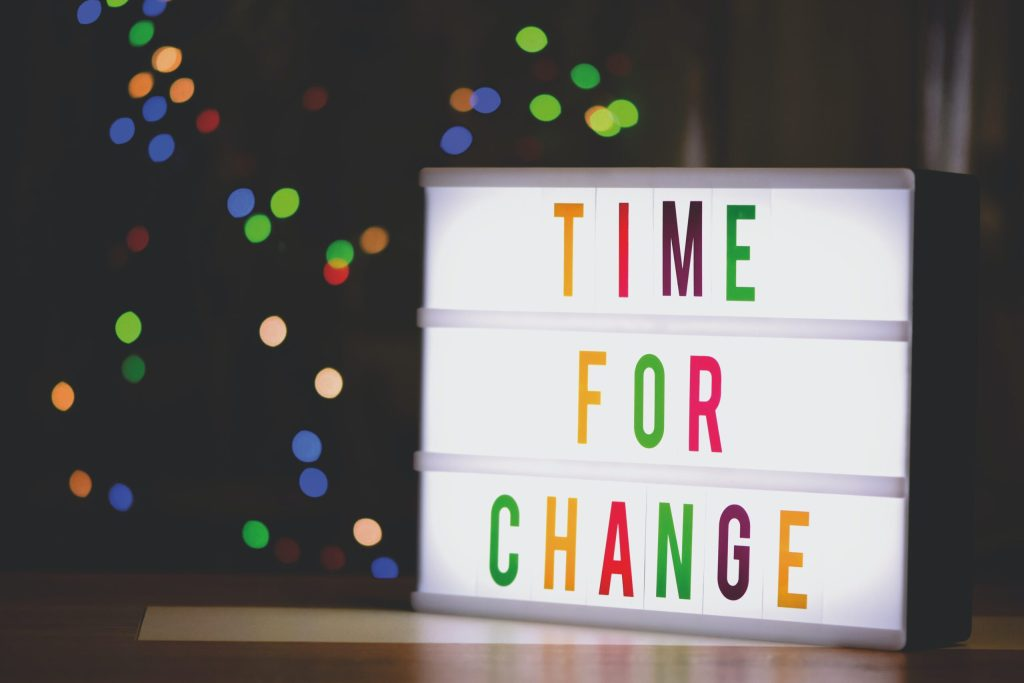 """Lightbox displaying coloured letters spelling """"Time For Change"""""""