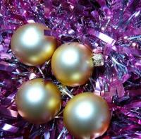 silver balls with purple ribbons