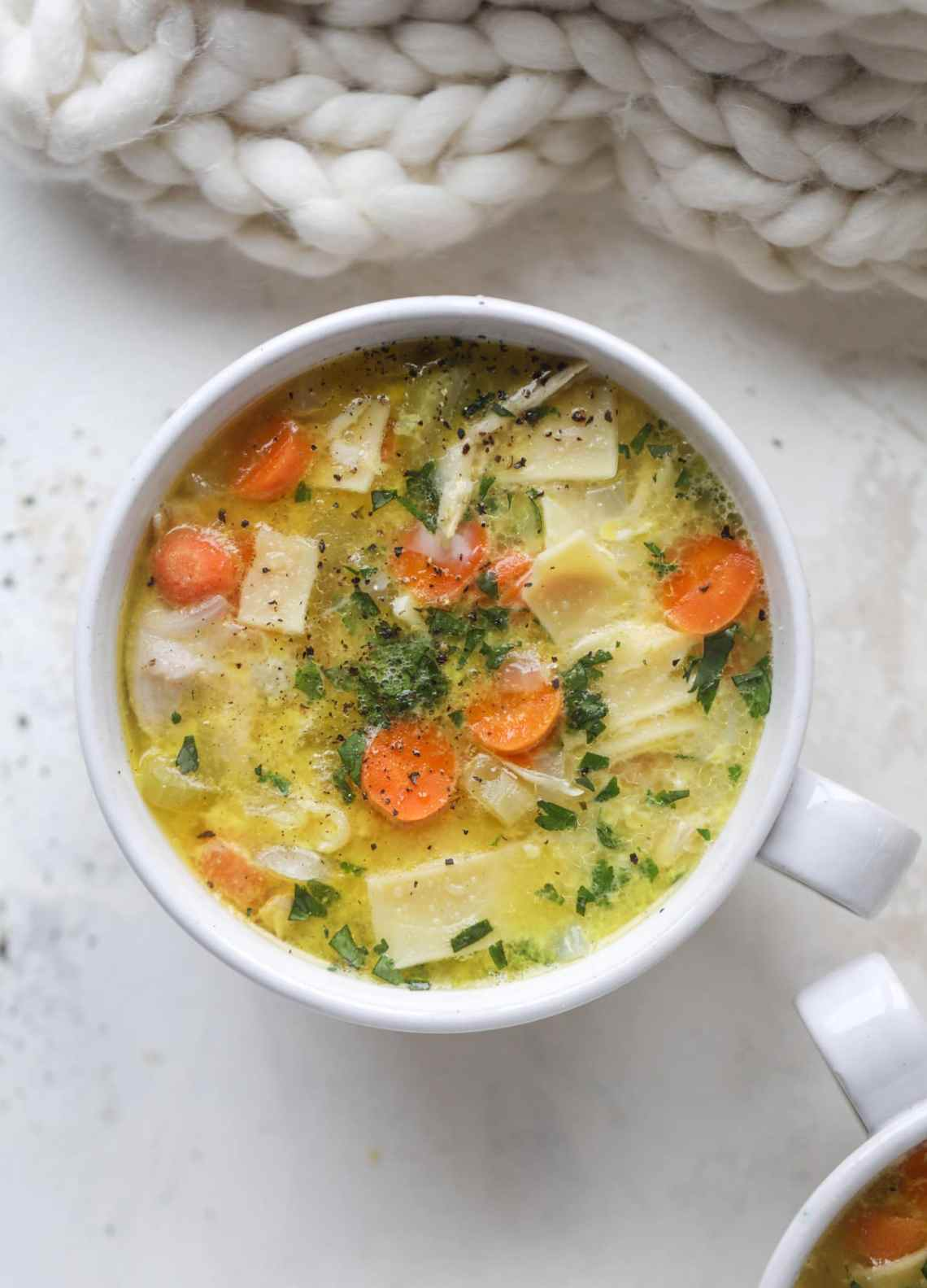 This chicken noodle egg drop soup is the ultimate comfort food! Homemade stock and satisfying ingredients provide the best nourishment and comfort! I howsweeteats.com #chicken #noodlesoup