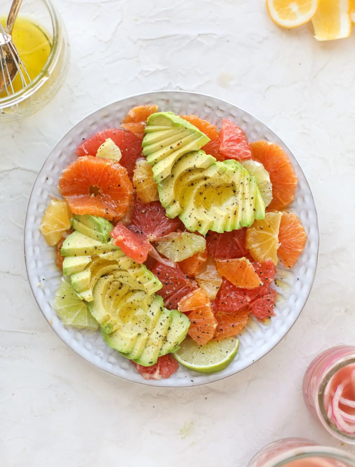 A deliciously fresh and invigorating avocado citrus salad with honey lime vinaigrette. It's creamy, tart, sweet and refreshing! I howsweeteats.com #avocado #citrussalad