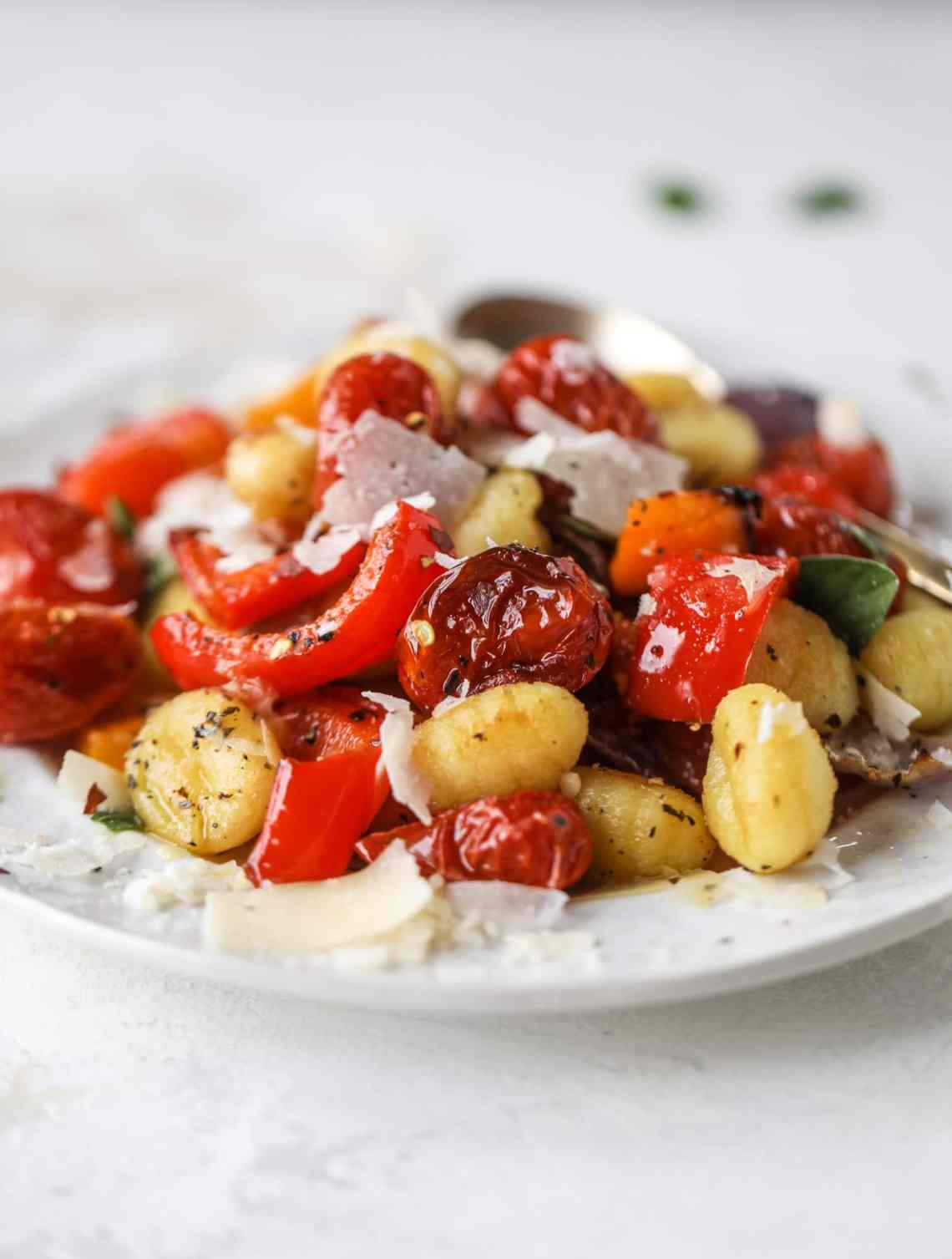 Sheet pan gnocchi is an easy meal that the whole family will love! Toasted gnocchi along with burst tomatoes and caramelized peppers makes the best dinner. I howsweeteats.com #sheetpan #gnocchi