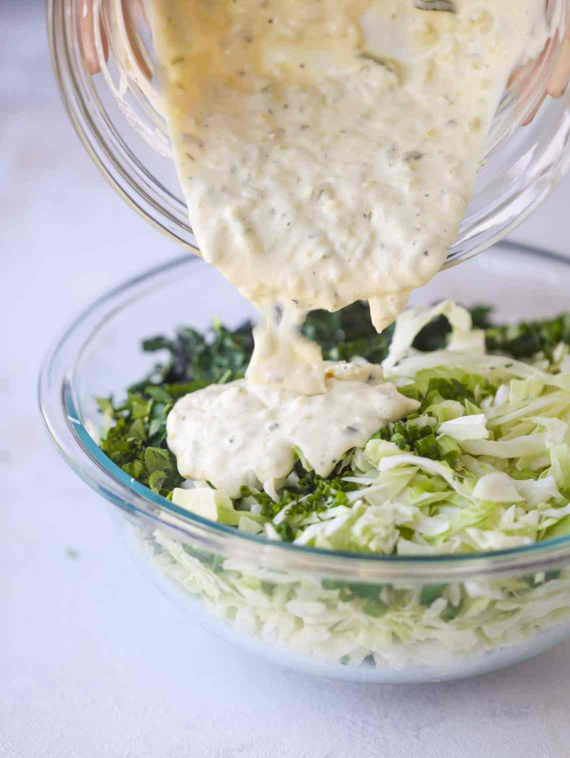 A light and crispy fish sandwich made with a simple beer batter and topped with a hearty, creamy kale cole slaw. Loaded with flavor! I howsweeteats.com #crispyfish #sandwich