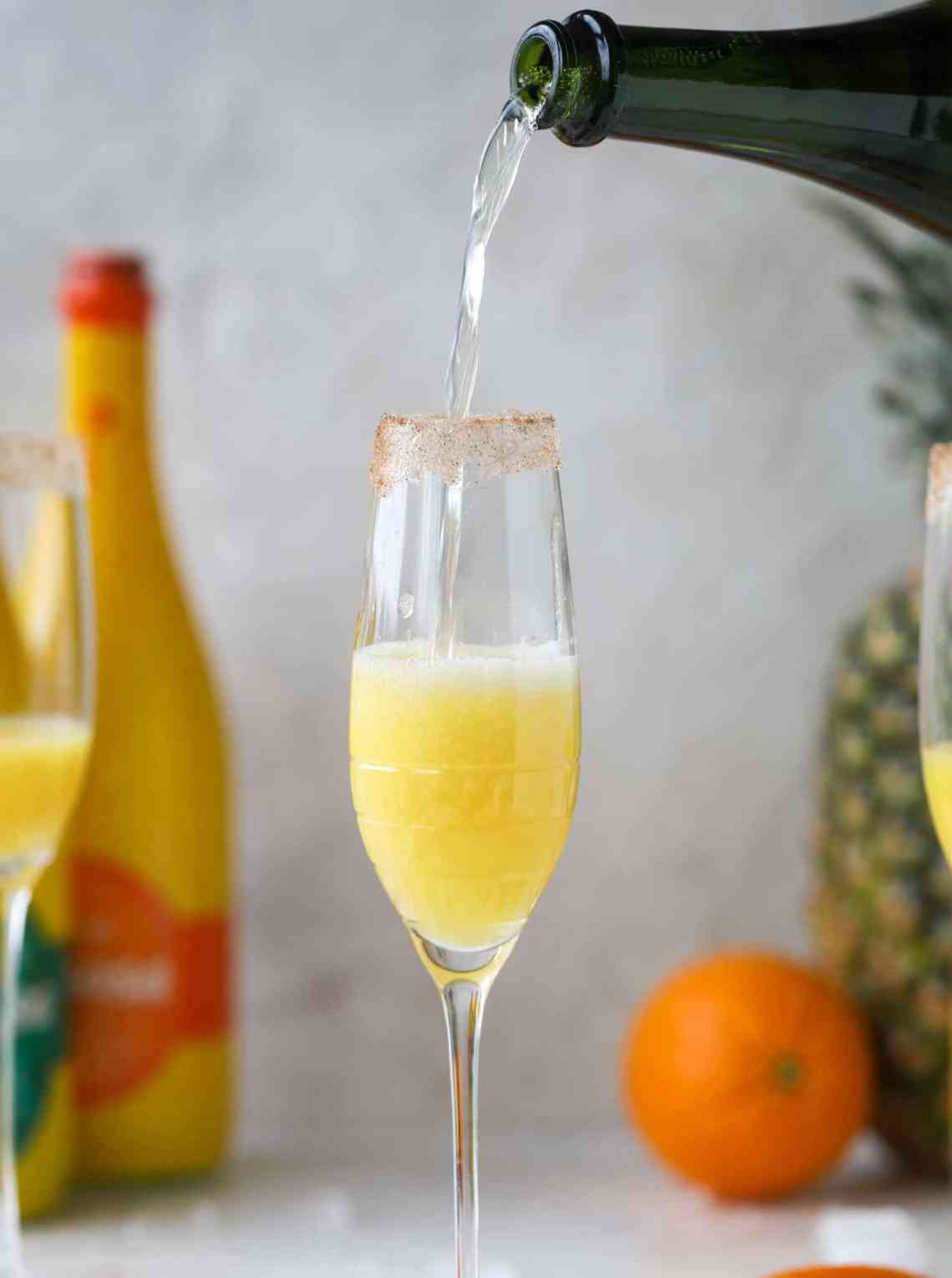 champagne pour into a mimosa