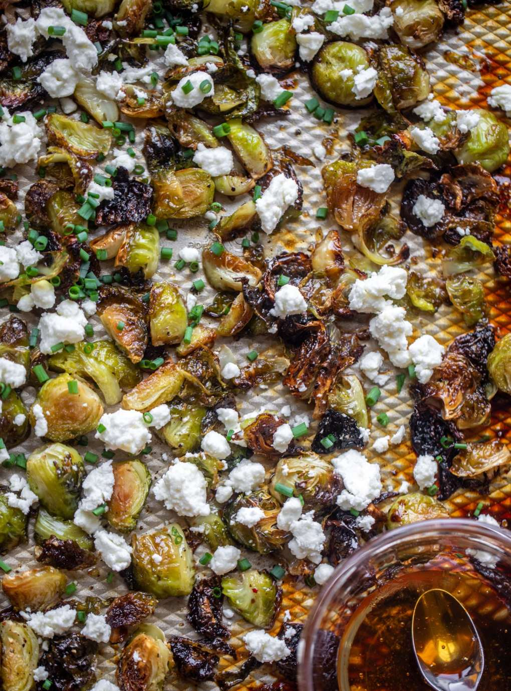 hot honey roasted brussels sprouts on a sheet pan