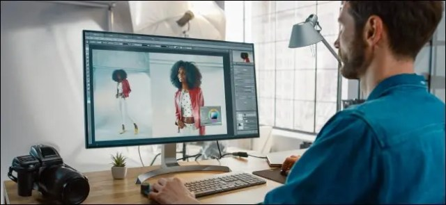 A professional photographer editing images in Photoshop.