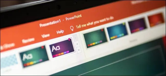 The Microsoft PowerPoint ribbon on a computer monitor.