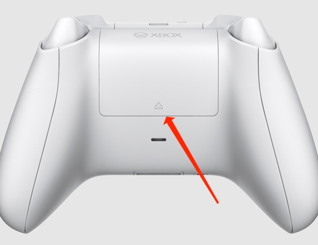 Gently slide up the battery cover to reveal the batteries powering the Xbox Wireless Controller.