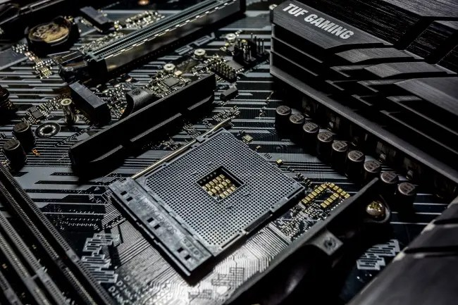 An empty AMD CPU socket on a motherboard.