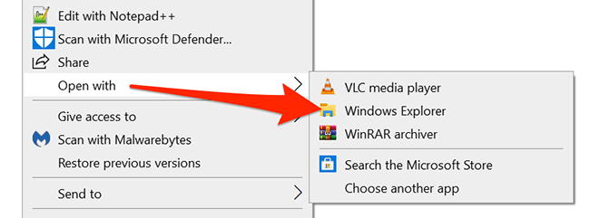 Right-click the ZIP archive and select Open With > Windows Explorer.