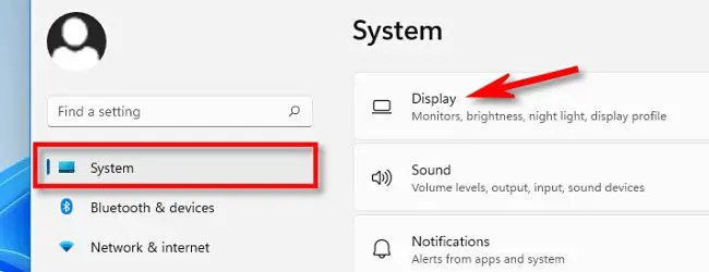 """In Settings, click """"System,"""" then select """"Display."""""""
