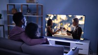 young-couple-watching-television.jpg?width=1198&trim=1%2c1&bg-color=000&pad=1%2c1