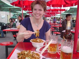 Amy thoroughly enjoying her first meal in China