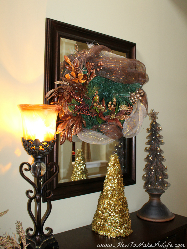 Bronze wreath and trees front hallway