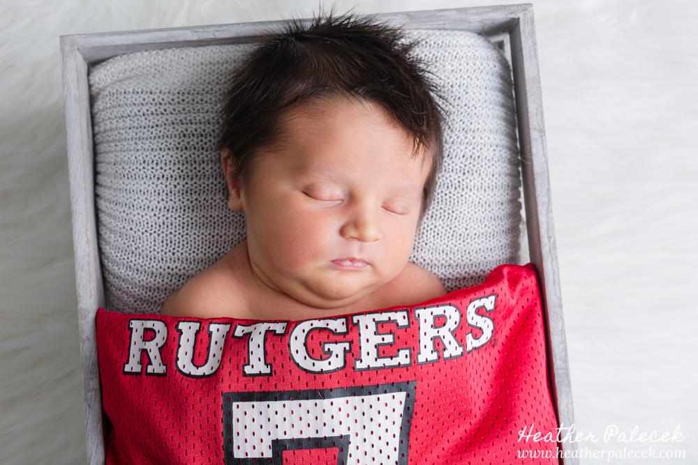 newborn photo with rutgers jersey