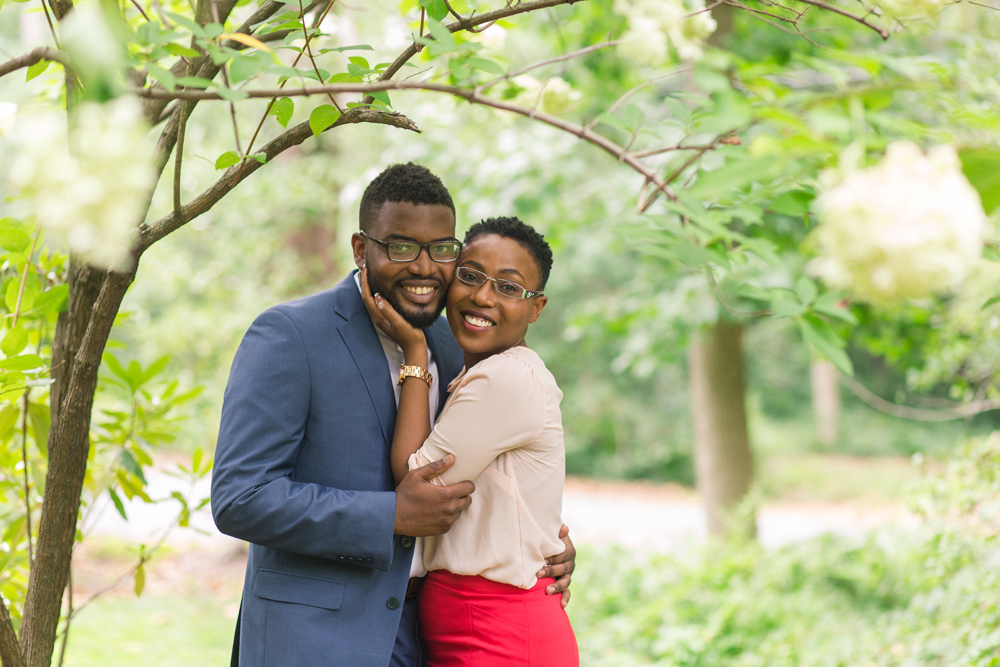 happy couple embracing under tree