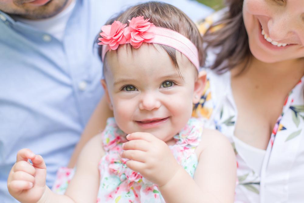 first birthday portrait in floral dress