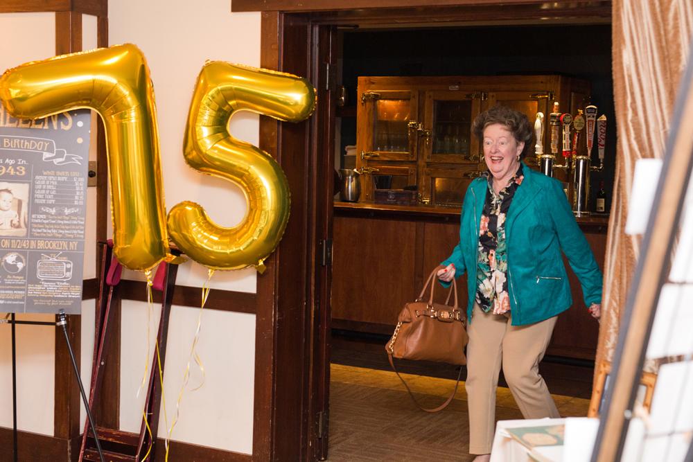 woman walks into surprise party