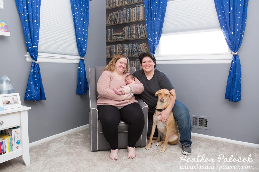 family portrait with newborn in nursery