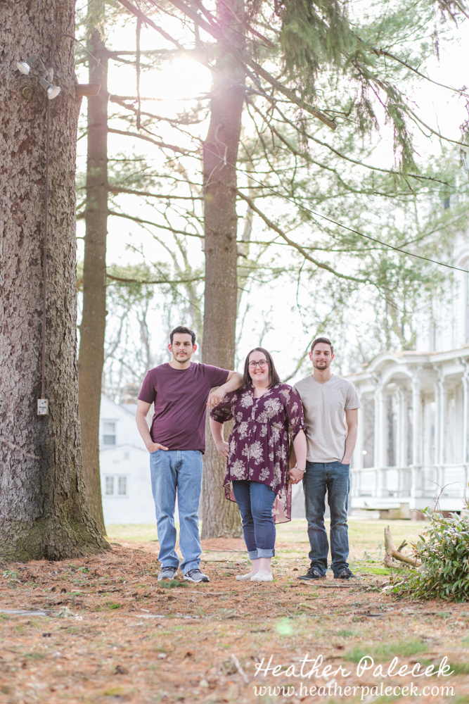 family portrait in pine trees