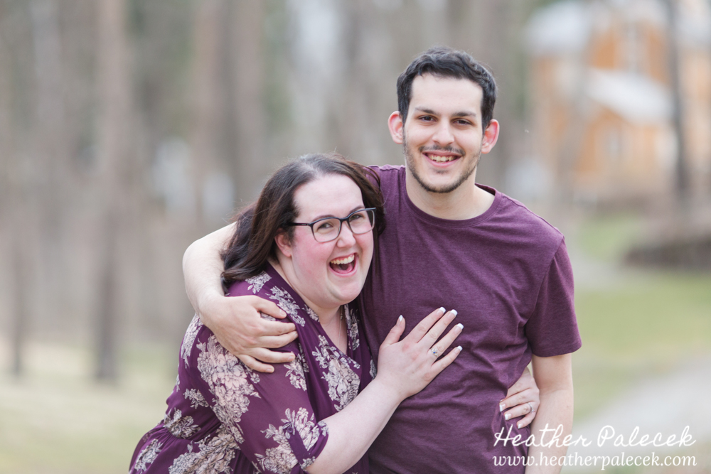 brother and sister laughing pose