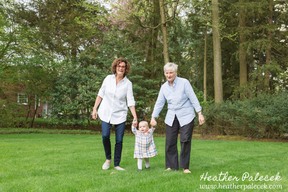 grandma holding hands and walking granddaughter