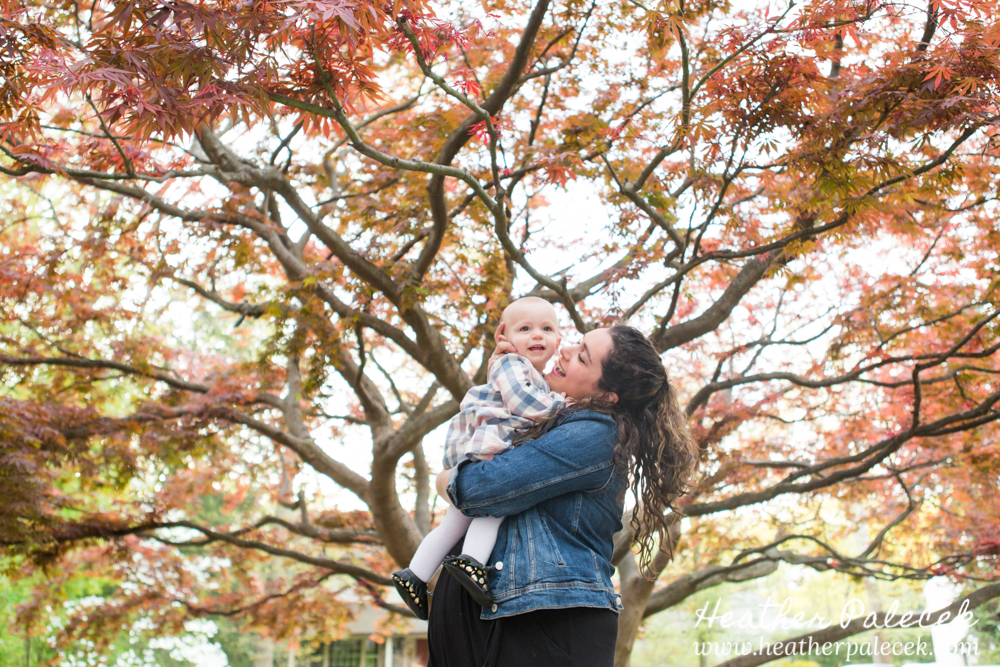 mother and daughter under japanese maple tree