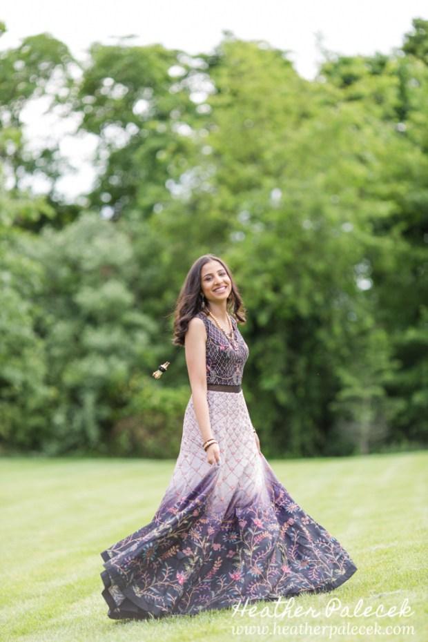 teenage girl twirls in dress for sweet sixteen portrait session