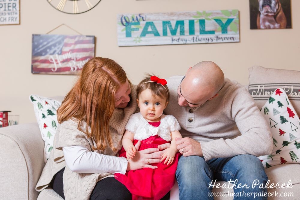 Family pose on couch in winter family session
