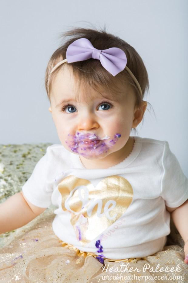 Snowflakes, Gold, and Purple 1st Birthday Cake Smash