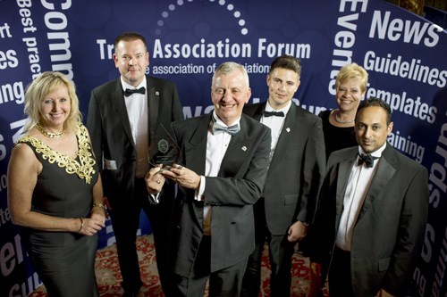 Jon celebrates the award with other members of the BMF team