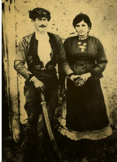 Michael Zachariou Charonitis and his wife Theonimphy and with his sword staff  in hand.