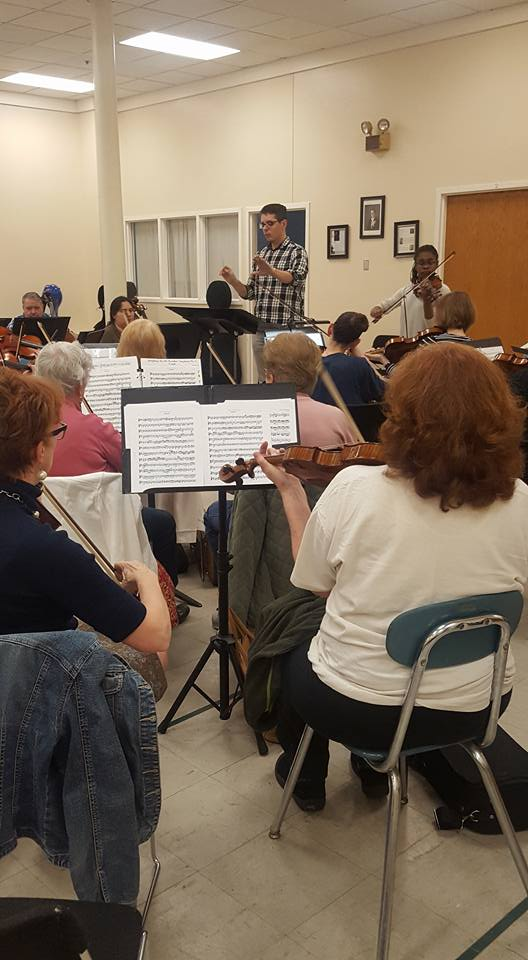 Orchestra auditions and practices together with conductor at front