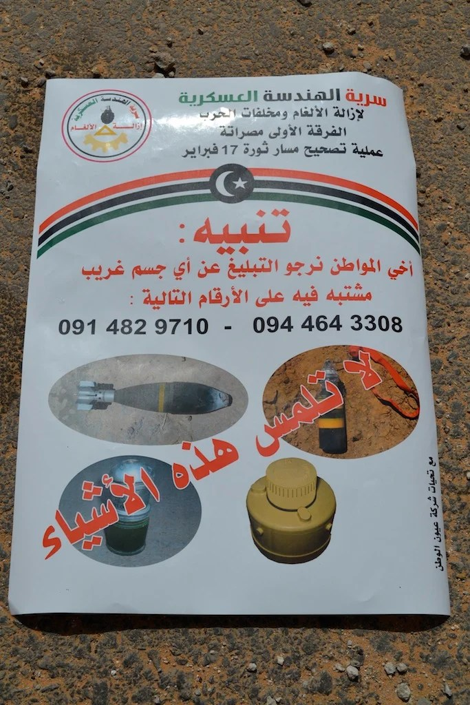 <p>A poster at Tripoli International Airport in September urges civilians to report any landmines or unexploded ordnance, including T-AB-1 antipersonnel mines (bottom right).</p>